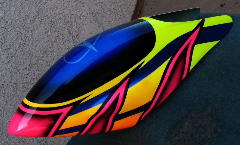 I airbrushed a similar design on a smaller canopy a year ago for my T-Rex 450. I added some blue stripes and an Airtronics logo. & FarrellF.com